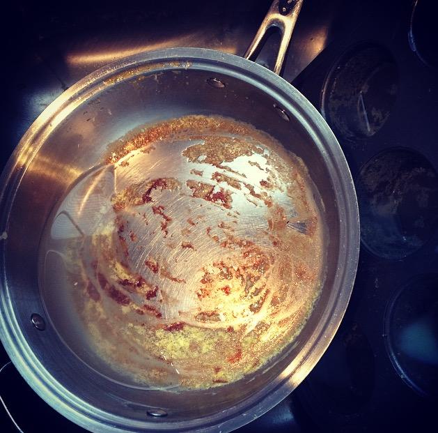 Dirty pan stuck on food